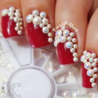 Red Nails With Pearls Nail Art Design