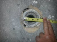 How to remove a metal shower drain