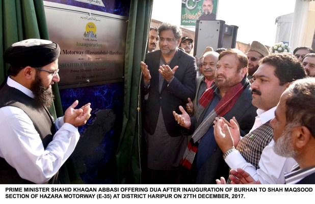 PRIME MINISTER SHAHID KHAQAN ABBASI OFFERING DUA AFTER INAUGURATION OF BURHAN TO SHAH MAQSOOD SECTION OF HAZARA MOTORWAY (E-35) AT DISTRICT HARIPUR ON 27TH DECEMBER, 2017.
