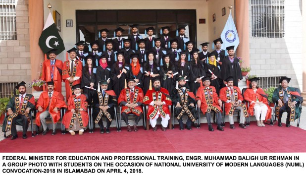 FEDERAL MINISTER FOR EDUCATION AND PROFESSIONAL TRAINING, ENGR. MUHAMMAD BALIGH UR REHMAN IN A GROUP PHOTO WITH STUDENTS ON THE OCCASION OF NATIONAL UNIVERSITY OF MODERN LANGUAGES (NUML) CONVOCATION-2018 IN ISLAMABAD ON APRIL 4, 2018.