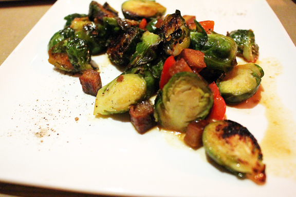 """Seared Brussels Sprouts appetizer with """"pickled chiles, smoked tofu, orange miso""""."""