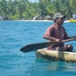 Kuna Man in a Hand Built Canoe