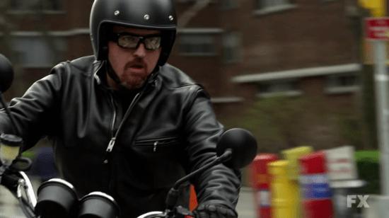 Louis CK on a Triumph Scrambler Motorcycle