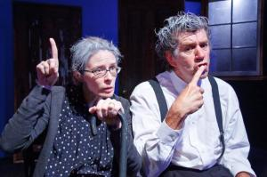"""Scene from Ionesco's """"The Chairs,"""" starring Cynthia Mance and Bo Roberts, at City Garage Theatre."""