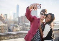 Couple taking selfie on rooftop