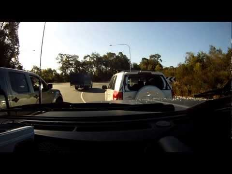 08-11-2012 - Driver of a white SUV brake checks camera car at a clear round-a-bout, causes collision (Noosaville, Noosa)