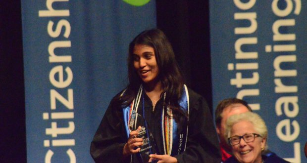 Star Student--Oswego resident Rebecca Mohan, left, received the Aurora University Spartan Award, the school's top student honor, at an annual honors convocation Friday, April 22, in Crimi Auditorium. Background right is Rebecca L. Sherrick, AU president. Mohan, an Oswego High School graduate, is a senior health science major. Her award was presented by Lora deLacey, vice president for student life. (Al Benson Photo)