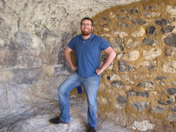 A manly man in an Indian cave dwelling.