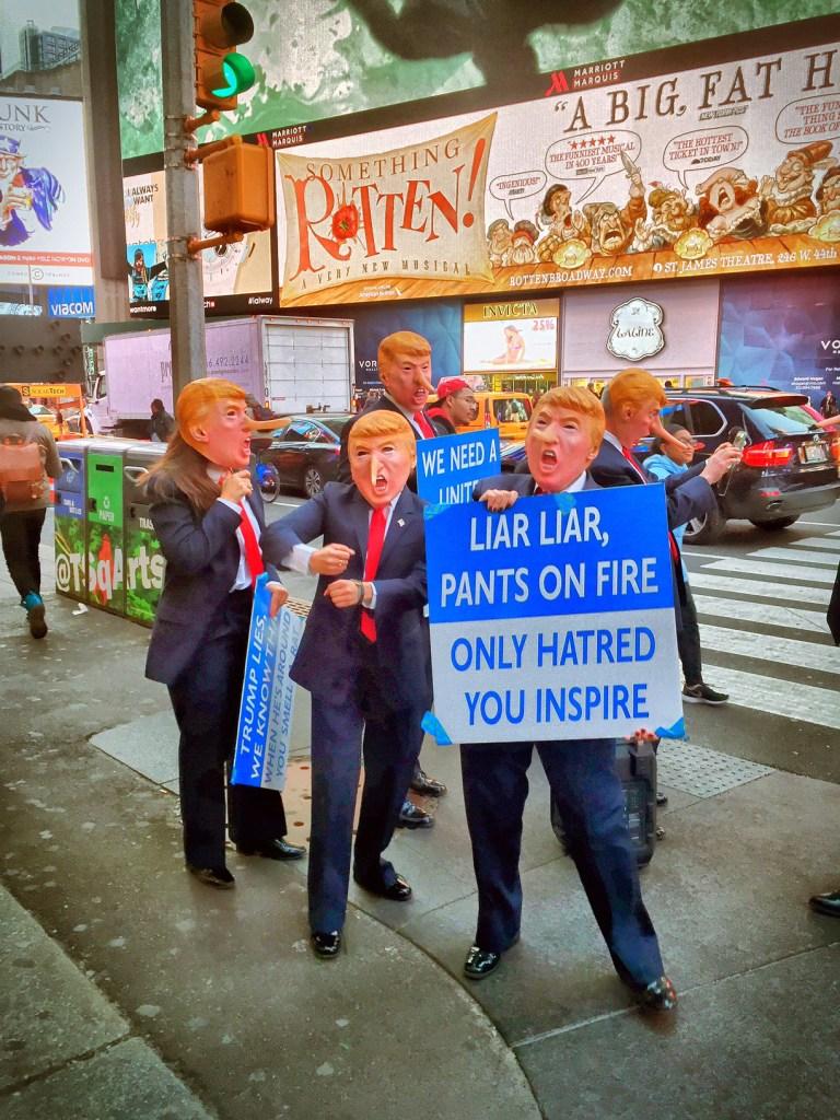 trump demonstrators times square new york city