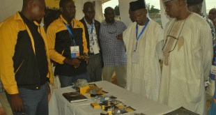 Olaolu Olusina, Managing Editor, Auto Report Africa, the Authorised GeBe Trader/Agent for IKA Germany in Nigeria, intoduces the GeBe products range on display as Kaduna State Government officials led by the Commissioner for Works, Housing and Transport, Engr. Hassan Usman, who represented the State Governor, Mallam Nasir el-Rufai, listen with rapt attention during a visit to  IKA Germany's pavilion at the First Kaduna Automotive Parts Expo on Thursday, October 5, 2017. The venue was the Kaduna Township Stadium (formerly Ranchers Bees Stadium) in Kaduna,