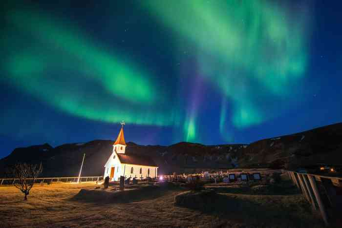 Church And Aurora Borealis In Vik, Iceland.