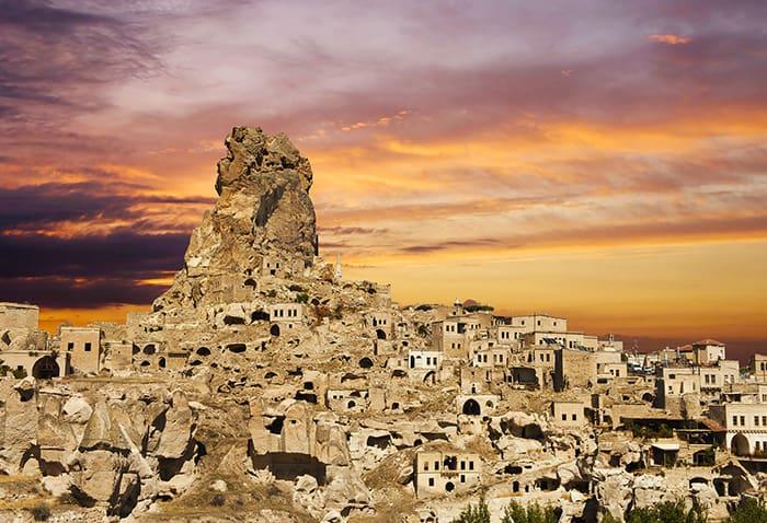 bigstock-Ortahisar-castle-at-sunset-Ca-78955024resize
