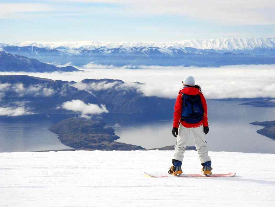 snowboarder takes in the awesome view from cardrona new zealand