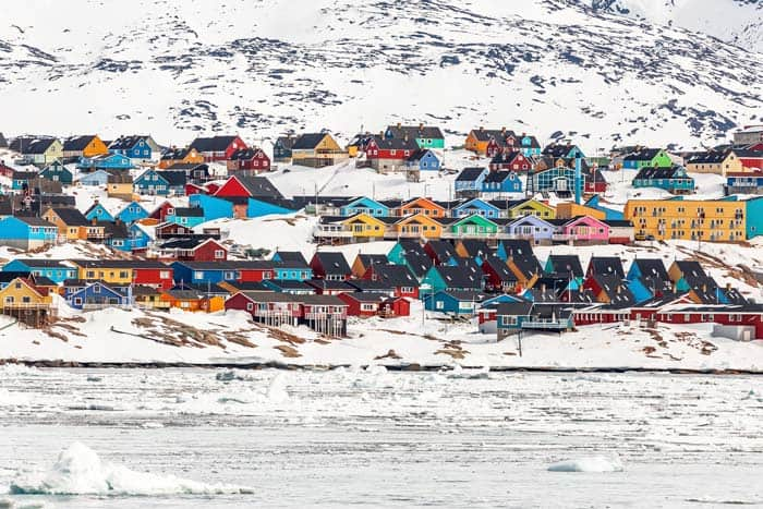 Ilulissat, Greenland! Click through to see some of the most colorful cities in the world! This post does not contain industrial soot stained cities; instead it showcases some of the most vibrant looking cities in the world.