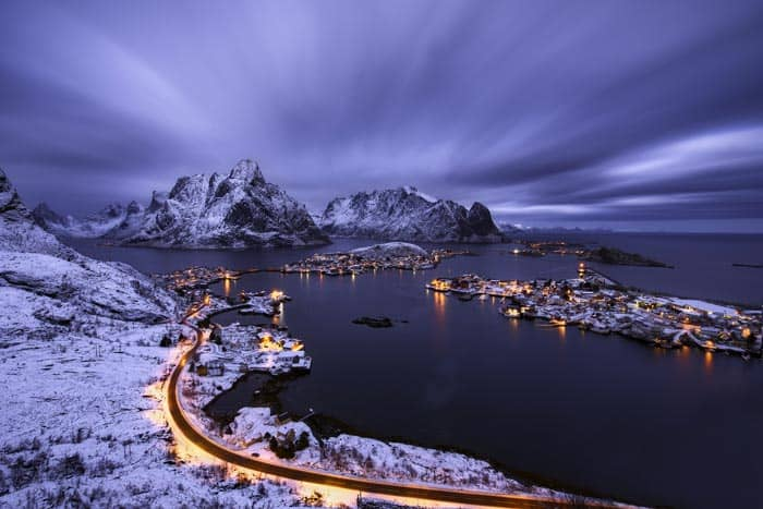 Roads in Reine lit up at night.