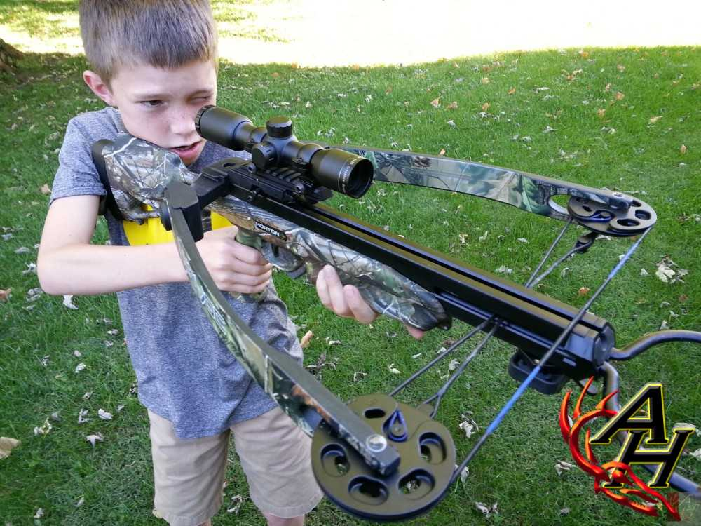 boy shooting crossbow