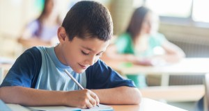 Boy writing featured image