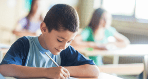 boy-writing-smiling-featured-image