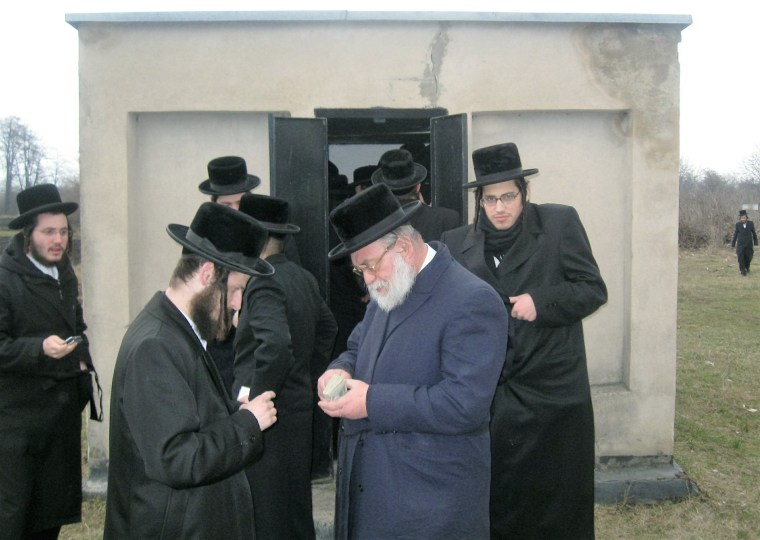 1 - Chassidim visiting the Shpoler Ze ida's Ohel in the Shpola Cemetery