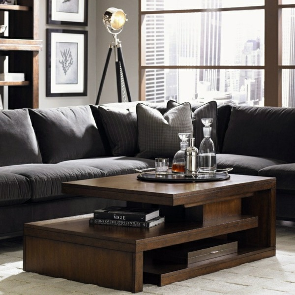 A wooden coffee table in the living room adds warmth and - tables for living room