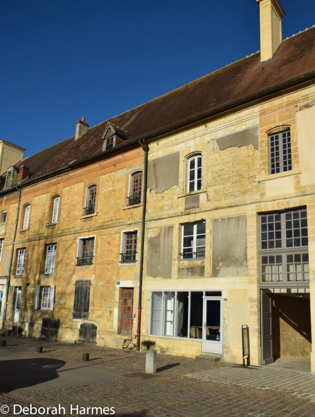 These are the buildings along the outer part of the Abbey complex -- the ones that are facing the gardens in the illustration above. The French government sold these buildings off after the Revolution and they have gradually been repurchased. Some of them are in perilous condition and are being properly renovated now.