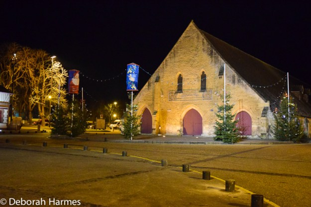 A cold and wintery night outside the medieval market hall in Saint-Pierre-sur-Dives in the Calvados region of Normandy, France at Christmas time.