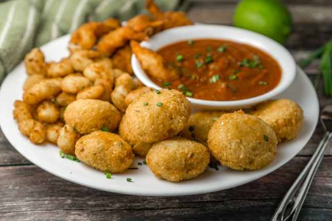 Cheesy Grits Fritters with Cajun Marinara Dip. Get the recipe here .
