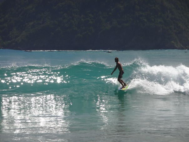 Local catching some surf (Indonesia, 2016).