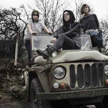 Photo of Tongue Trap band sitting on an car by Rachel O'Donnell