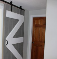 Barn Door and Whitewashed Shiplap in Little Mans Bedroom