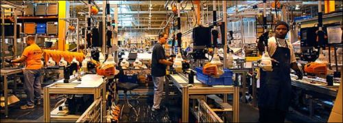 VIrginia Beach may have no hard-driving steel workers, but it does have Stihl workers, as shown here at the Stihl chainsaw manufacturing plant.