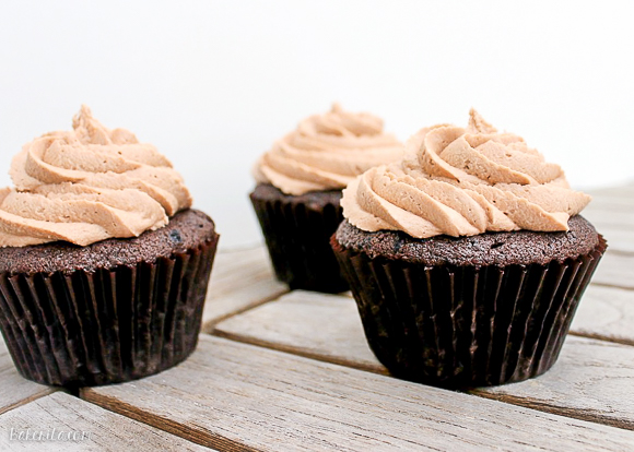 These Chocolate Cupcakes with Nutella Buttercream have a Ferrero Rocher truffle stuffed inside! Everyone will love these surprise inside cupcakes.