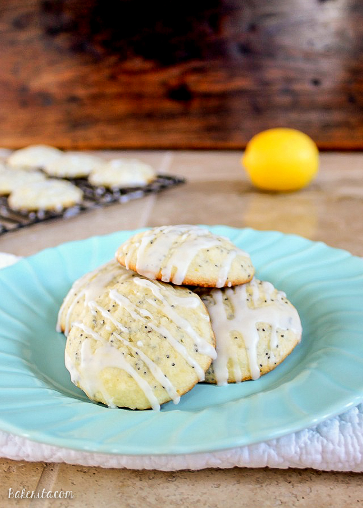 These sweet, cakey Lemon Poppy Seed Cookies get a lemony hit from both zest and juice, are studded with poppy seeds and completed with a delicious glaze!