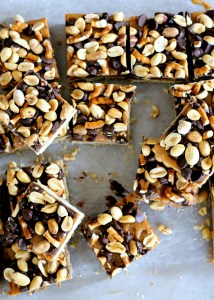 Fully Loaded Bars | Oat shortbread crust, peanut butter caramel, roasted peanuts, pretzels, and semi-sweet chocolate chips! [from bakerita.com]