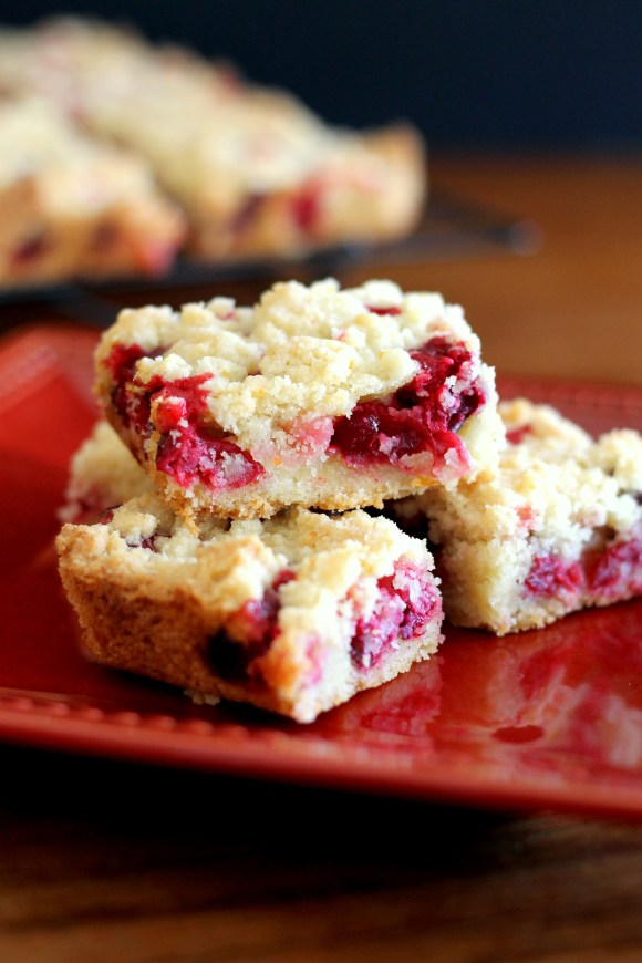 These easy Cranberry Crumb Bars are super portable, super delicious, and perfect for your holiday cookie platters!