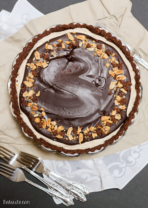 This No Bake Chocolate Peanut Butter Tart has a rich peanut butter filling topped with chocolate ganache for a decadent treat you won't believe is gluten free, refined sugar free, and vegan!