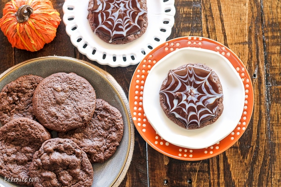 These Ultimate Chocolate Spiderweb Cookies are perfect for Halloween! They're double chocolate cookies, full of chocolate chunks, and topped with white and dark chocolate ganache.