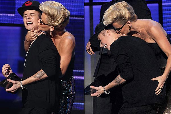 Jenny McCarthy fondles Justin Bieber on-stage at the 2012 American Music Awards.