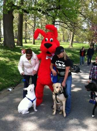 Red Ruff, the Petco mascot, encouraged participants to visit his information booth. The white dog looks dubious.