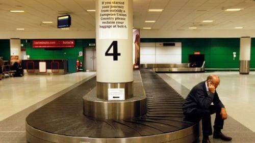 business-traveler-waits-luggage