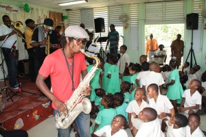 Joseph Callendar playing for the children at All Saints Primary School