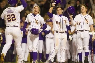 LSU catcher Kade Scivicque is gretted at home plate after his 3-run HR in the 2nd inning vs. Kansas.