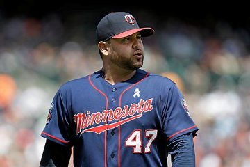Minnesota Twins pitcher Ricky Nolasco walks to the dugout after being relieved in the sixth inning of a baseball game against the Detroit Tigers in Detroit, Sunday, June 15, 2014. (AP Photo/Paul Sancya)