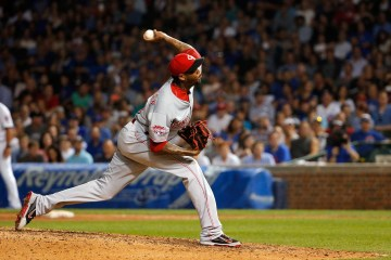 CHICAGO, IL - AUGUST 31: Aroldis Chapman #54 of the Cincinnati Reds pitches against the Chicago Cubs during the eighth inning at Wrigley Field on August 31, 2015 in Chicago, Illinois.  (Photo by Jon Durr/Getty Images)