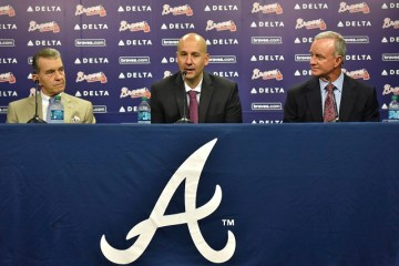 New Atlanta Braves general manager John Coppolella, center, speaks as Atlanta Braves President John Schuerholz, left, and Braves president of baseball operations John Hart look on  during a news conference at Turner Field on Thursday, Oct. 1, 2015 in Atlanta. The Atlanta Braves have promoted John Coppolella to general manager following three seasons as assistant GM. The move was announced on Thursday by Braves president of baseball operations John Hart. The team said in a statement Coppolella has agreed to a four-year contract through the 2019 season, a term that will include the Braves' first three seasons at their new SunTrust Park. (Hyosub Shin/Atlanta Journal-Constitution via AP)  MARIETTA DAILY OUT; GWINNETT DAILY POST OUT; LOCAL TELEVISION OUT; WXIA-TV OUT; WGCL-TV OUT; MANDATORY CREDIT