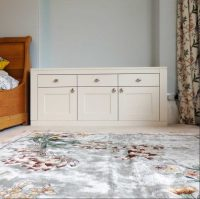 Curved walk in dressing room and bedside dressers