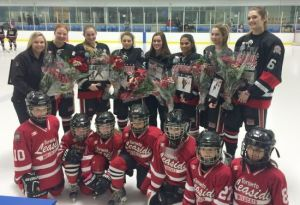Roses and applause for departing Wildcat Friends