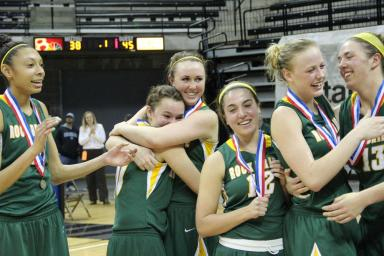 The girls (left to right: Junior Kayla Cheadle, seniors Makenzie Skrabal and Kennedy Smith, junior Laura Frew,  sophomore Sophie Cunningham and junior Audrey Holt) embrace each other after the medal ceremony. Photo by Daphne Yu