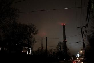 Eight twenty. The smokestacks greet me as I crest a hill, but they're partially lost in mist. My feet start to get cold.