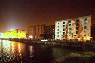 Photograph of Lennon by Bill Zygmant, projected onto the Albert Dock, Liverpool, October 2010